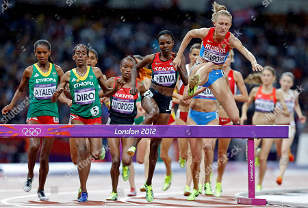 Russia's Yuliya Zaripova leads the way in the women's 300-meter steeplechase during the athletics in the Olympic Stadium at the 2012 Summer Olympics, London