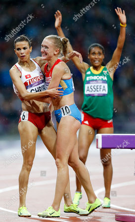 Russia's Yuliya Zaripova celebrates with Tunisia's Habiba Ghribi and Ethiopia's Sofia Assefa after the gold medal in the women's 3000-meter steeplechase during the athletics in the Olympic Stadium at the 2012 Summer Olympics, London