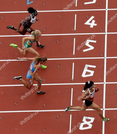 Turkey's Nevin Yanit wins her heat during round 1 of the women's 100-meter hurdles during the athletics in the Olympic Stadium at the 2012 Summer Olympics, London