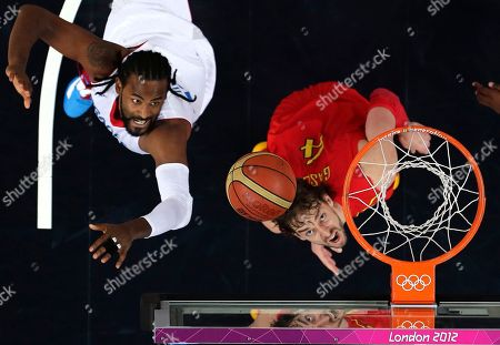Ronny Turiaf, Pau Gasol France's Ronny Turiaf, left, and Spain's Pau Gasol eye a rebound during a men's quarterfinals basketball game at the 2012 Summer Olympics, in London