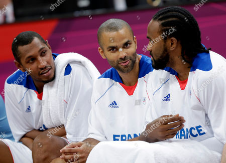 Ronny Turiaf, Boris Diaw, Tony Parker France's Boris Diaw, left, Tony Parker, center, and Ronny Turiaf, right, chat on the bench during a preliminary men's basketball game against Nigeria at the 2012 Summer Olympics, in London