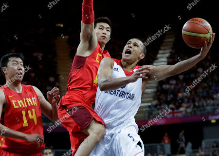 Andrew Lawrence, Wang Zhizhi,Guo Ailun Great Britain's Andrew Lawrence, right, is defended by China's Wang Zhizhi (14) and Guo Ailun, center, as he tries to score during a preliminary men's basketball game at the 2012 Summer Olympics, in London