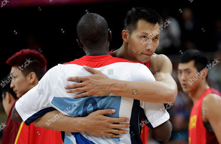 Yi Jianlian, Luol Deng China's Yi Jianlian, right, hugs Britain's Luol Deng, left, after their preliminary men's basketball game at the 2012 Summer Olympics, in London