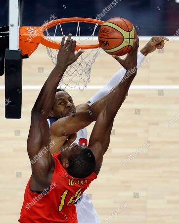 Spain's Serge Ibaka puts up a shot against United States' Andre Iguodala during the men's gold medal basketball game at the 2012 Summer Olympics, in London