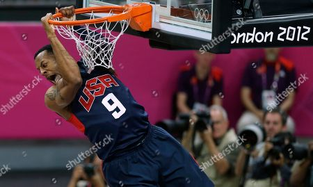 United States' Andre Iguodala reacts after slaming a dunk during a preliminary men's basketball game against Argentina at the 2012 Summer Olympics, in London