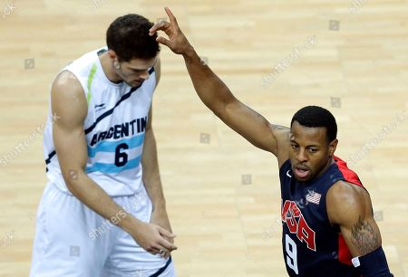 United States' Andre Iguodala, right, celebrates next to Argentina's Marcos Mata, left, in the second half of the preliminary men's basketball game at the 2012 Summer Olympics, in London