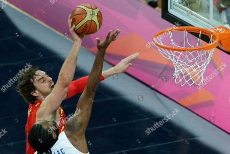 Spain's Pau Gasol, left, shoots over France's Ronny Turiaf during a quarterfinal men's basketball game at the 2012 Summer Olympics, in London