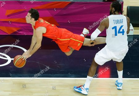 France's Ronny Turiaf, right, commits an unsportsmanlike foul against Spain's Rudy Fernandez, left, in the final moments of a quarterfinal men's basketball game at the 2012 Summer Olympics, in London