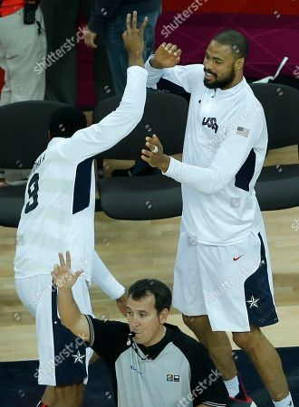 United States' Tyson Chandler, right, celebrates with teammate Andre Iguodala, left, after a three point basket by United States' Kobe Bryant during a quarterfinal men's basketball game against Australia at the 2012 Summer Olympics, in London