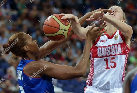 Emilie Gomis, Nadezhda Grishaeva France's Emilie Gomis, left, and Russia's Nadezhda Grishaeva battle for a rebound during a women's semifinals basketball game at the 2012 Summer Olympics, in London