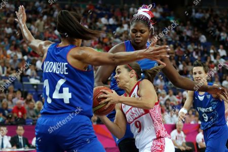 Emmeline Ndongue, Isabelle Yacoubou, Becky Hammon France's Emmeline Ndongue, left, and Isabelle Yacoubou, right, try to trap Russia's Becky Hammon (9) on a drive to the basket during a women's semifinals basketball game at the 2012 Summer Olympics, in London