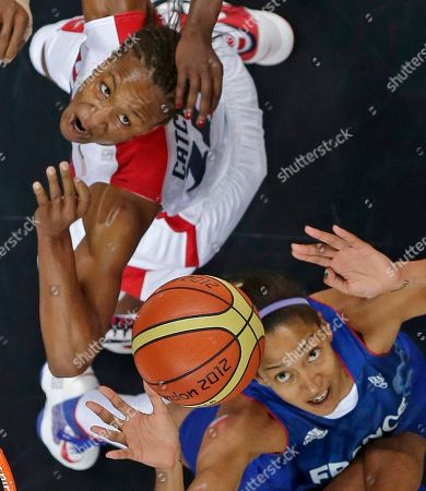 Tamika Catchings, Emmeline Ndongue United States' Tamika Catchings, top, and France's Emmeline Ndongue battle for a rebound during the women's gold medal basketball game at the 2012 Summer Olympics, in London
