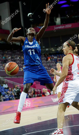 Becky Hammon, Emilie Gomis France's Emilie Gomis (11) loses control fo the ball as Russia's Becky Hammon, right, defends during a semifinal women's basketball game at the 2012 Summer Olympics, in London