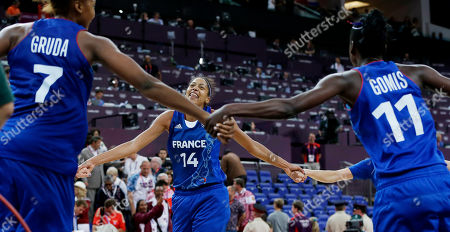 Emmeline Ndongue, Sandrine Gruda, Emilie Gomis France's Emmeline Ndongue (14) dances with Sandrine Gruda (7), Emilie Gomis (11) and other teammates after they defeated Russia in a semifinal women's basketball game at the 2012 Summer Olympics, in London
