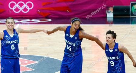 Clemence Beikes, Emmeline Ndongue, Celine Dumerc France women's basketball players, from left, Clemence Beikes, Emmeline Ndongue and Celine Dumerc react after a women's gold medal basketball game against the United States at the 2012 Summer Olympics, in London. The U.S. won 86-50