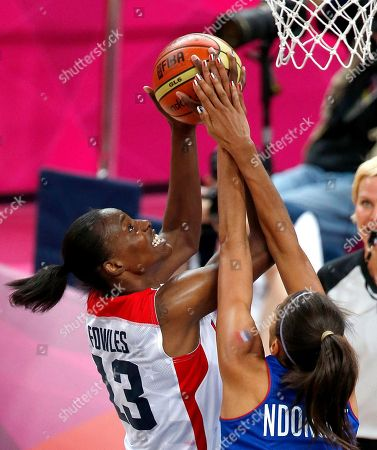 Sylvia Fowles, Emmeline Ndongue United States' Sylvia Fowles, left, goes up for a shot against France's Emmeline Ndongue during a women's gold medal basketball game at the 2012 Summer Olympics, in London