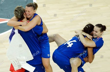 From left, France's players Celine Dumerc, Florence Lepron, Emmeline Ndongue and Clemence Beikes celebrate after defeating Russia in a women's basketball semifinal game at the 2012 Summer Olympics, in London