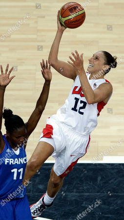 United States' Diana Taurasi, right, shoots for the basket past France's Emilie Gomis during a women's gold medal basketball game at the 2012 Summer Olympics, in London