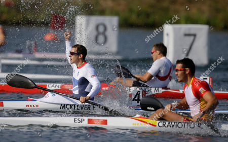 Great Britain's Ed McKeever, left, celebrates after winning a gold medal in the men's kayak single 200m in Eton Dorney, near Windsor, England, at the 2012 Summer Olympics, . Spain's Saul Craviotto Rivero, who won the silver medal, is at right