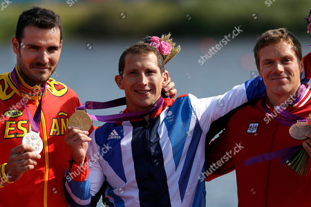 The winners of the men's kayak single 200m pose at the podium in Eton Dorney, near Windsor, England, at the 2012 Summer Olympics, . From left to right, Spain's Saul Craviotto Rivero, silver medal, Great Britain's Ed McKeever, gold medal, and Canada's Mark de Jonge, bronze medal