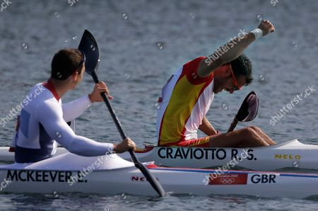 Spain's Saul Craviotto Rivero, right, celebrates after winning the silver medal for the men's kayak single 200m in Eton Dorney, near Windsor, England, at the 2012 Summer Olympics, . Great Britain's Ed McKeever, left, won the gold medal