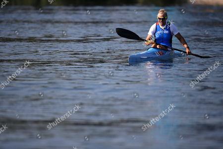 Italy's Josefa Idem paddles after the women's kayak single 500m final in Eton Dorney, near Windsor, England, at the 2012 Summer Olympics