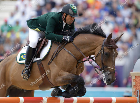 Brazil's Alvaro Affonso De Miranda Neto rides Rahmannshof's Bogeno, during the equestrian show jumping team competition at the 2012 Summer Olympics, in London