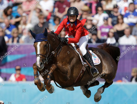 Reed Kessler, of the United States, completes the course on her horse Cylana, during the equestrian show jumping team competition at the 2012 Summer Olympics, in London