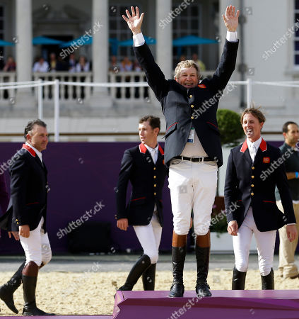 Nick Skelton, Ben Maher, Scott Brash, Peter Charles Great Britain's Peter Charles, Scott Brash, Nick Skelton and Ben Maher, from left, arrive at the medal ceremony to receive the gold medal in the equestrian show jumping team competition, at the 2012 Summer Olympics, in London