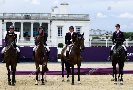 Nick Skelton, Ben Maher, Scott Brash, Peter Charles Great Britain's Peter Charles with horse Vindicat, Scott Brash with horse Hello Sanctos, Nick Skelton with horse Big Star and Ben Maher with horse Tripple X, from left, pose for media after receiving the gold medal in the equestrian show jumping team competition, at the 2012 Summer Olympics, in London