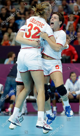 Montenegro's Katarina Bulatovic (32) and team mate Ana Dokic celebrate after defeating France in their women's handball quarterfinal match at the 2012 Summer Olympics, in London