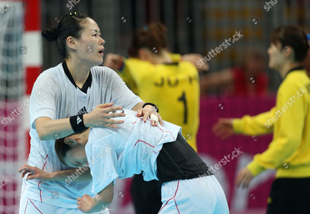 South Korea's Kim Cha-youn, left, comforts Woo Sun-hee, right, after the women's handball bronze medal match against Spain at the 2012 Summer Olympics, in London