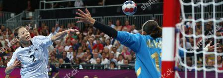 South Korea's Woo Sun-hee, left, shoots to score past Spain's Silvia Navarro Jimenez, right, during the women's handball bronze medal match at the 2012 Summer Olympics, in London