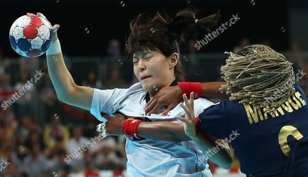 Spain's Marta Mangue Gonzalez, right, tries to block South Korea's Woo Sun-hee, left, during the women's handball bronze medal match at the 2012 Summer Olympics, in London