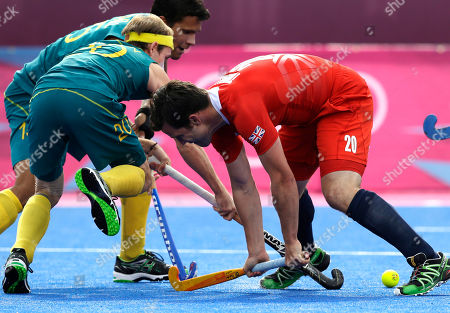 Matthew Swann, James Tindall Great Britain's James Tindall, right, and Australia's Matthew Swann battle for possession of the ball in the men's hockey bronze medal match at the 2012 Summer Olympics, in London. Australia won 3-1 to take the bronze