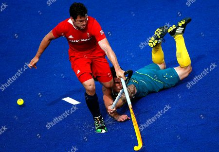 Stock Image of Kieran Govers, James Tindall Britain's James Tindall, left, and Australia's Kieran Govers fight for the ball during a men's hockey bronze medal match at the 2012 Summer Olympics, London, . Australia won the match