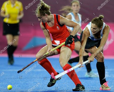 Laura Bartlett, Luciana Aymar Britain's Laura Bartlett, left, and Argentina's Luciana Aymar battle for possession of the ball during a women's hockey semifinal match at the 2012 Summer Olympics, in London