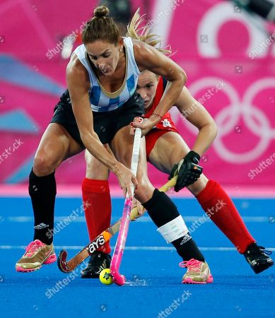 Rocio Sanchez Moccia, Laura Bartlett Argentina's Rocio Sanchez Moccia, right, and Britain's Laura Bartlett vie for the ball during a women's hockey semifinal match at the 2012 Summer Olympics, in London