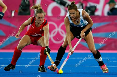Rocio Sanchez Moccia, Laura Bartlett Argentina's Rocio Sanchez Moccia, right, and Britain's Laura Bartlett vie for the ball in the women's hockey semifinal match at the 2012 Summer Olympics, in London