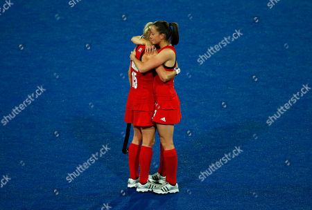 Emily Maguire, Alex Danson Britain's Alex Danson, left, and Emily Maguire console one another after loosing to Argentina in a women's hockey semifinal match at the 2012 Summer Olympics, in London