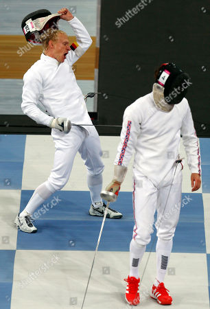 Steffen Gebhardt, right, of Germany reacts after defeating Nicholas Woodbridge of Britain during the men's fencing section of the modern pentathlon at the 2012 Summer Olympics, in London
