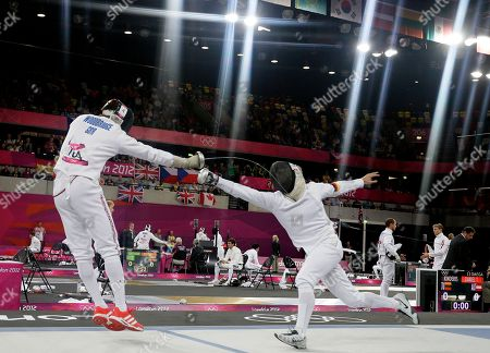 Steffen Gebhardt of Germany, right, and Nicholas Woodbridge of Britain compete during the fencing section of the men's modern pentathlon at the 2012 Summer Olympics, in London