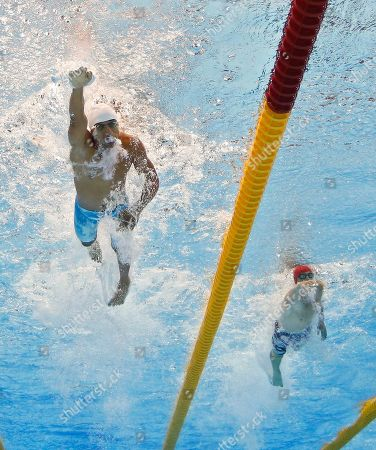 Amro El Geziry,Nicholas Woodbridge Amro El Geziry of Egypt, left, and Nicholas Woodbridge of Great Britain swim the 200-meter freestyle during the swimming portion of the men's modern pentathlon at the Aquatics Centre in the Olympic Park during the 2012 Summer Olympics in London