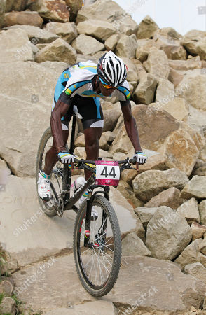 Stock Image of Adrien Niyonshuti Rwanda's Adrien Niyonshuti (44) competes in the Mountain Bike Cycling men's race, at the 2012 Summer Olympics, at Hadleigh Farm, in Essex, England. No matter how Niyonshuti does, the London Games represent a remarkable achievement for Rwanda -its seven athletes at these Olympics are the most it has ever sent to any games - and for Niyonshuti, who survived his country's genocide in 1994