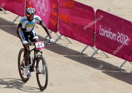 Rwanda's Adrien Niyonshuti competes in the Mountain Bike Cycling men's race, at the 2012 Summer Olympics, at Hadleigh Farm, in Essex, England