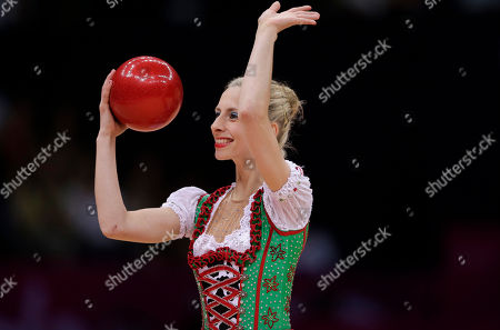 Stock Image of Austria's Caroline Weber, wearing a costume inspired by a traditional Austrian dress, performs during the rhythmic gymnastics individual all-around qualifications at at the 2012 Summer Olympics, in London