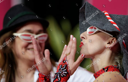 Stock Picture of Austria's Caroline Weber, right, blows kisses watched by her coach during the rhythmic gymnastics individual all-around qualifications at the 2012 Summer Olympics, in London