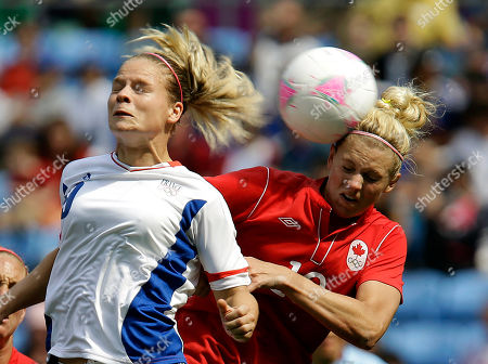France's Eugenie Le Sommer, left, heads the ball against Canada's Lauren Sesselmann, right, during their women's bronze medal soccer match at the 2012 London Summer Olympics, in Coventry, England
