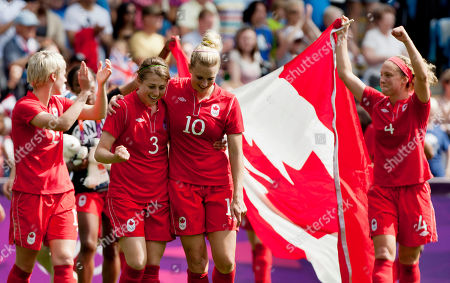 Canada's Lauren Sesselmann, center, celebrates with teammates after winning their bronze medal women's soccer match against France at the 2012 London Summer Olympics, at The Ricoh Arena Stadium in Coventry, England