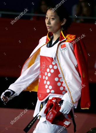 China's Hou Yuzhuo makes her way to fight United States' Diana Lopez in women's 57-kg taekwondo competition at the 2012 Summer Olympics, in London